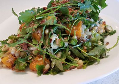Salad of roasted pumpkin, cannellini beans and coriander