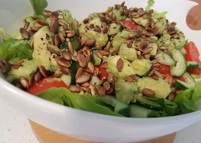 Green salad with avocado and pepita seeds